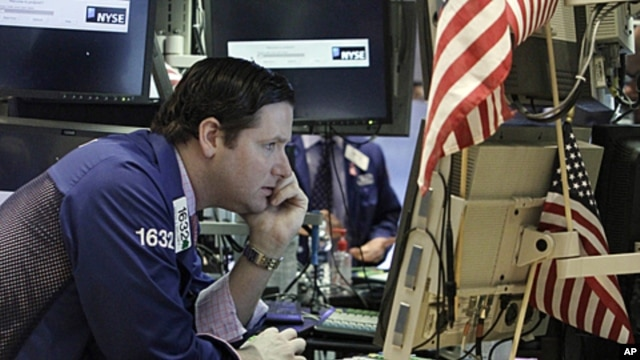 Specialist Gregg Maloney works at his post on the floor of the New York Stock Exchange Thursday, Aug. 18, 2011