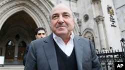 FILE - Self-exiled oligarch Boris Berezovsky leaves the High Court in London, March 10, 2010.