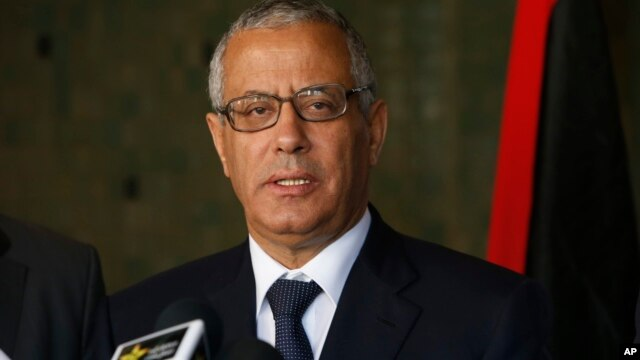 Libyan's Prime Minister Ali Zeidan speaks to the media during a press conference in Rabat, Morocco, Oct. 8, 2013