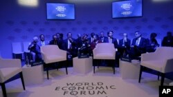 Attendees wait for the start of a session at the annual meeting of the World Economic Forum in Davos, Switzerland, Jan. 22, 2019.