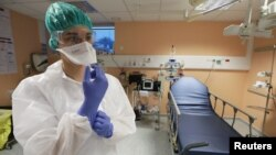A nurse wearing a protective gears is seen at Lenval pediatric hospital in Nice, France, March 5, 2020.