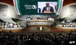 FILE - Chairperson of the African Union Commission Moussa Faki Mahamat delivers a speech during the African Union (AU) summit at the Palais des Congres in Niamey, Niger, July 7, 2019.