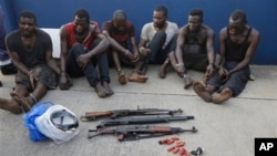 Arrested pirates that hijacked the Panama-flagged Maximus vessel are shown to the media in Lagos, Nigeria, Feb. 22, 2016. Acts of piracy have increased in the Gulf of Guinea area although piracy has been declining worldwide.