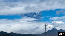 Ashes rise above the Cotopaxi volcano in the Andes mountains about 50km south of Quito, Ecuador, Aug. 14, 2015.