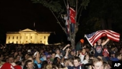 Crowds gathers outside the White House in Washington early Moday to celebrate after President Barack Obama announced the death of Osama bin Laden, May 2, 2011