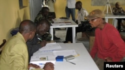 FILE - Nigerian security personnel register a former militant at an arms collection center in Ogoloma-Okrika district, east of Port Harcourt, as part of an amnesty program, Aug. 20, 2009. Paul Boroh, head of the amnesty program, was fired March 13, 2018, amid graft allegations.