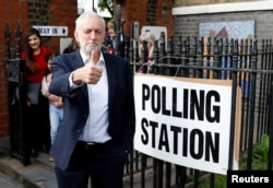 Britain's Labour Party leader Jeremy Corbyn gestures after voting at a local polling station in his constituency in London, May 23, 2019.