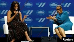 "U.S. first lady Michelle Obama and television presenter Oprah Winfrey participate in the White House's ""United State of Women"" summit in Washington, June 14, 2016."