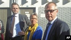 Kjell Persson (R) and Christina Persson (C), parents of Swedish photographer Johan Persson and Swedish ambassador to Ethiopia Jens Odlander (R), stand outside the courtroom in Ethiopia's capital Addis Ababa, December 21, 2011.