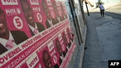 Election posters of presidential candidate Jovenel Moise of PHTK political Party are seen on a wall in Port-au-Prince, on Dec. 22, 2015.