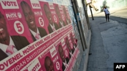 FILE - Election posters of presidential candidate Jovenel Moise of PHTK political Party are seen on a wall in Port-au-Prince, Dec. 22, 2015.