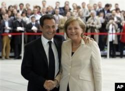 Angela Merkel et Nicolas Sarkozy (archives)