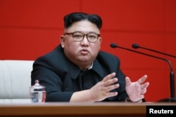 North Korean leader Kim Jong Un takes part in the 4th Plenary Meeting of the 7th Central Committee of the Workers' Party of Korea (WPK) in Pyongyang in this April 10, 2019, photo released April 11, 2019 by North Korea's Korean Central News Agency.