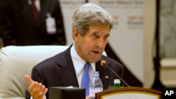 "U.S. Secretary of State John Kerry speaks during a meeting of the London 11 ""Friends of Syria"" meeting in Doha, Qatar, June 22, 2013."