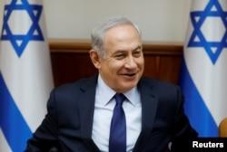 FILE - Israeli Prime Minister Benjamin Netanyahu attends the weekly cabinet meeting in Jerusalem, July 30, 2017.