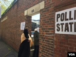 FILE - Voters are seen entering a polling station in London's largely Muslim Whitechapel neighborhood, London, May 5, 2016. (L. Ramirez/VOA)