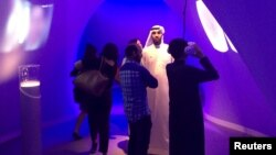People look at technology exhibits at the Museum of the Future, an innovation exhibition held at the World Government Summit, in Dubai, Feb. 10, 2016.