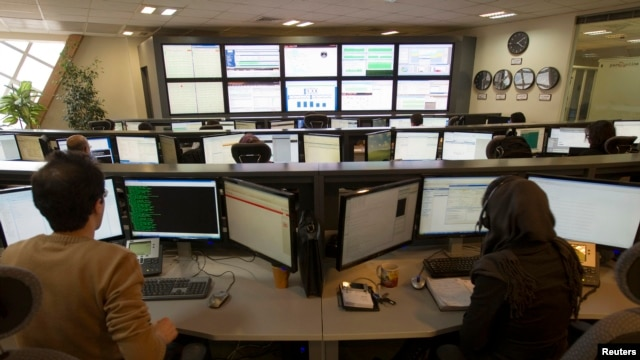 Technicians monitor data flow in the control room of an internet service provider in Tehran, Iran, Feb. 15, 2011.