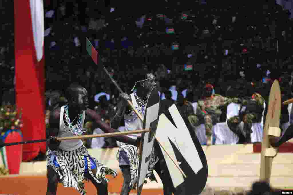 Actors perform a play during celebrations marking the third anniversary of South Sudan's independence in Juba, July 9, 2014.