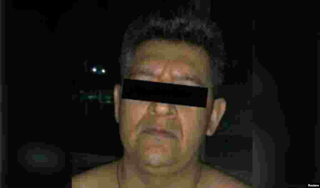 اریک «اِن»، متهم مرتبط با ناپدید شدن ۴۳ دانشجو در جنوب مکزیک در چهارسال پیش، که عکس او ۱۲ مارس توسط مقامات قضایی منتشر شده است.