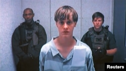 Dylann Storm Roof appears by closed-circuit television at his bond hearing in Charleston, South Carolina June 19, 2015 in a still image from video. A 21-year-old white man has been charged with nine counts of murder in connection with an attack on a histo