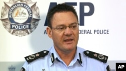 Australian Federal Police Deputy Commissioner Michael Phelan speaks to the media that two Sydney men have been arrested by the Joint Counter Terrorism team in Sydney, Australia, Wednesday, Dec. 24, 2014.