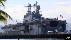 FILE - The amphibious assault ship USS Peleliu is seen docked following joint exercises at the Alava pier, off Subic Bay Freeport zone, northwestern Philippines, Oct. 13, 2014, as part of the Visiting Forces Agreement.