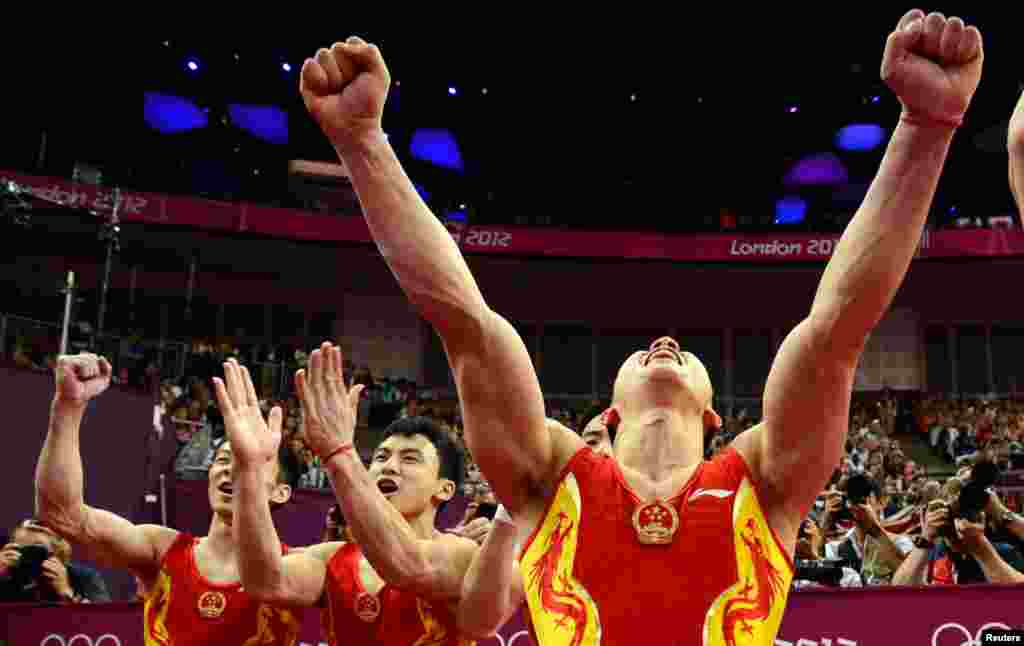 China's team celebrates after the men's gymnastics team final in the North Greenwich Arena.