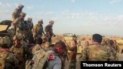 7일 아프간 특수 부대가 아프가니스탄 북부 쿤두즈에서 무장 장파 탈레반의 공격에 대비하고 있다.