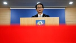 FILE - South Korea's Unification Minister Ryoo Kihl-jae releases a government statement during a news conference at the Unification Ministry in Seoul.