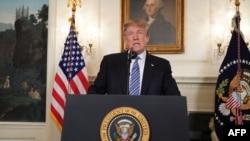 Le président américain Donald Trump parle de la fusillade en Floride, depuis la Maison-Blanche à Washington, le 15 février 2018.