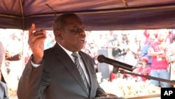 MDC President Morgan Tsvangirai addresses mourners at the burial of activist Rebecca Mafukeni in Harare, Aug. 14, 2013.