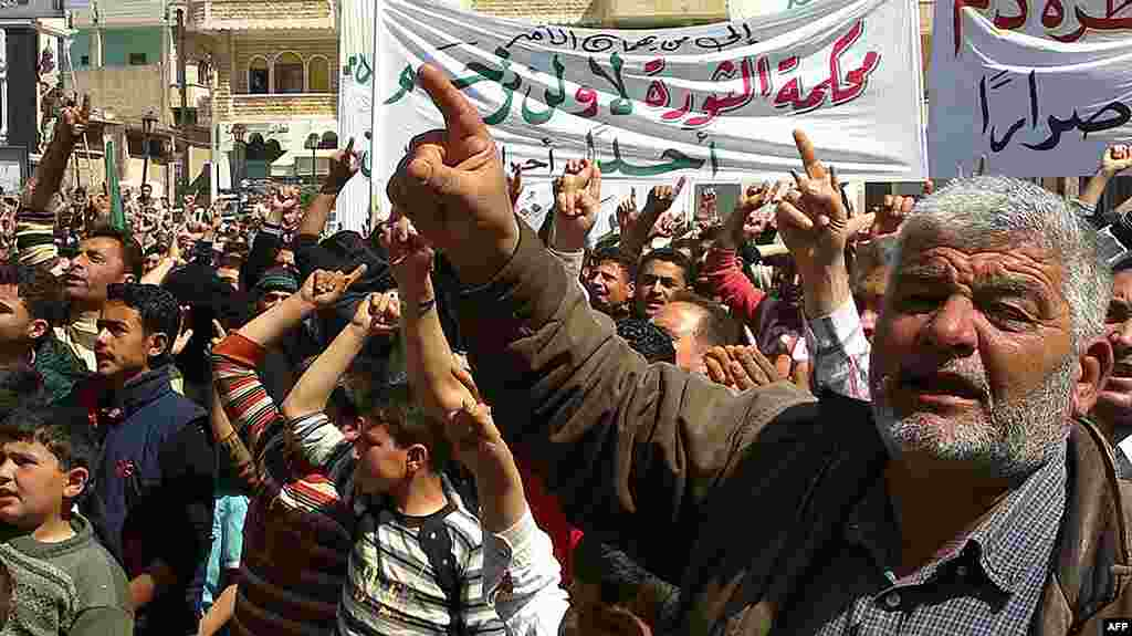 This citizen journalism image shows anti-regime protesters in Binish, Idlib, March 26, 2012. (AP/Edlib News Network)