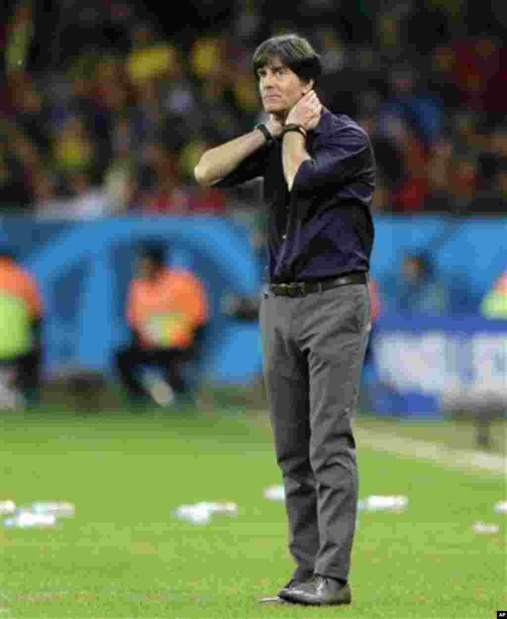 Germany's head coach Joachim Loew watches his team from the sidelines during the World Cup round of 16 soccer match between Germany and Algeria at the Estadio Beira-Rio in Porto Alegre, Brazil, Monday, June 30, 2014. (AP Photo/Matthias Schrader)