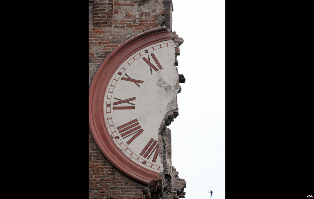 The damaged clock tower of Finale Emilia, Italy, May 20, 2012. A magnitude 6 earthquake shook northern Italy early May 20, killing at least four people. (AP Photo/Gianfilippo Oggioni, Lapresse)