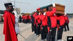 Pallbearers carry the coffins of Togo national soccer team assistant coach Abalo Amelete (front), and media officer Stanislas Ocloo during a funeral procession in Lome, Togo, 15 Jan 2010
