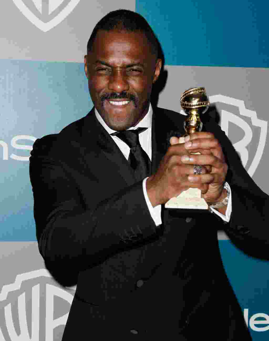 "Idris Elba arrives at the 2012 Warner Bros. and InStyle Golden Globe After Party at the Beverly Hilton in Los Angeles. on January 15, 2012. He won Best Performance by an Actor in a Mini-Series or Motion Picture Made for Television for ""Luther."" (AP)"