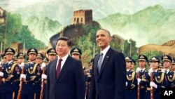 Chinese President Xi Jinping, left, and U.S. President Obama at the Great Hall of the People in Beijing, China, Nov. 12, 2014. (AP Photo/Andy Wong)