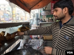 Manoj Kumar is opting for a mobile payment channel after suffering a huge dip in business due to cash shortages. (A. Pasricha/VOA)