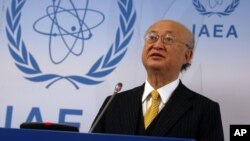 FILE - International Atomic Energy Agency chief Yukiya Amano addresses the media during a news conference at the International Center in Vienna, Austria, Jan. 19, 2016.