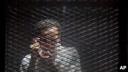 Le photojournaliste égyptien Mahmoud Abu Zeid, dit Shawkan, dans sa cellule de prison à Tora au Caire, en Égypte, le 28 juillet 2018.