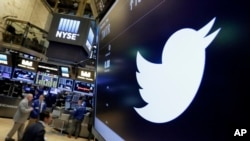 FILE - The Twitter symbol appears above a trading post on the floor of the New York Stock Exchange, July 27, 2016.
