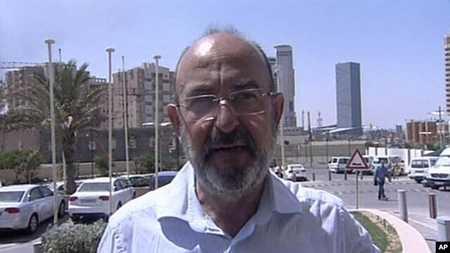 In this image made from television, Italian journalist Claudio Monici of Avvenire, the daily of the Italian bishops conference, speaks to reporters in Tripoli, Libya, Aug. 25, 2011, after his release