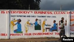 Lukisan dinding yang menggambarkan instruksi kesehatan dalam perawatan pasien virus Ebola di Monrovia (18/11). (Reuters/James Giahyue)