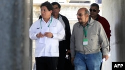 Nicaragua's Foregin Minister Denis Moncada (L), along with deputies Edwin Castro (R), Wilfredo Navarro (R back) and Jose Figueroa, leave as members of the opposition Civic Alliance failed to attend talks between the opposition and the government, in Managua, March 11, 2019.