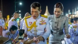 King Maha Vajiralongkorn and Queen Suthida greet supporters in Bangkok, Thailand, Sunday, Nov. 1, 2020. Under increasing pressure from protesters demanding reforms to the monarchy, Thailand's king and queen met Sunday with thousands of adoring supporters in Bangkok, mixing with c