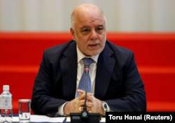 FILE - Iraqi Prime Minister Haider al-Abadi speaks during a conference in Tokyo, Japan, April 5, 2018.