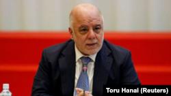 Imagen de archivo del primer ministro de Irak Haider al-Abadi hablando durante una conferencia sobre apoyo al trabajo para facilitar la reducción de armas en la sociedad iraquí, en Tokio, Japón, el 5 de abril de 2018. REUTERS/Toru Hanai