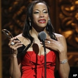 "Nikki M. James accepts the Tony Award for Best Performance by an Actress in a Featured Role in a Musical for ""The Book of Mormon"" during the 65th annual Tony Awards in New York, June 12, 2011."