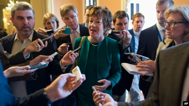 Sen. Susan Collins, R-Maine, talks with reporters after arriving on Capitol Hill on Oct. 11, 2013, following a meeting between Republican senators and President Obama at the White House.